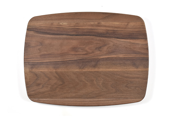 Walnut rectangular curved cutting board with rounded corners