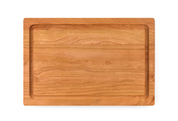 Small cherry board with rounded edges and juice groove