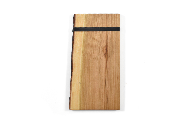 Artisan live edge cherry wood check presenter with rubber band