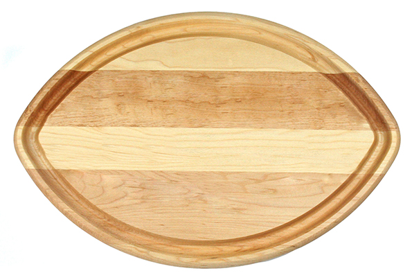 Football shaped cutting board with juice groove