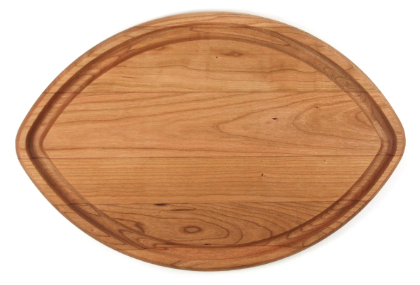 Football shaped cherry cutting board