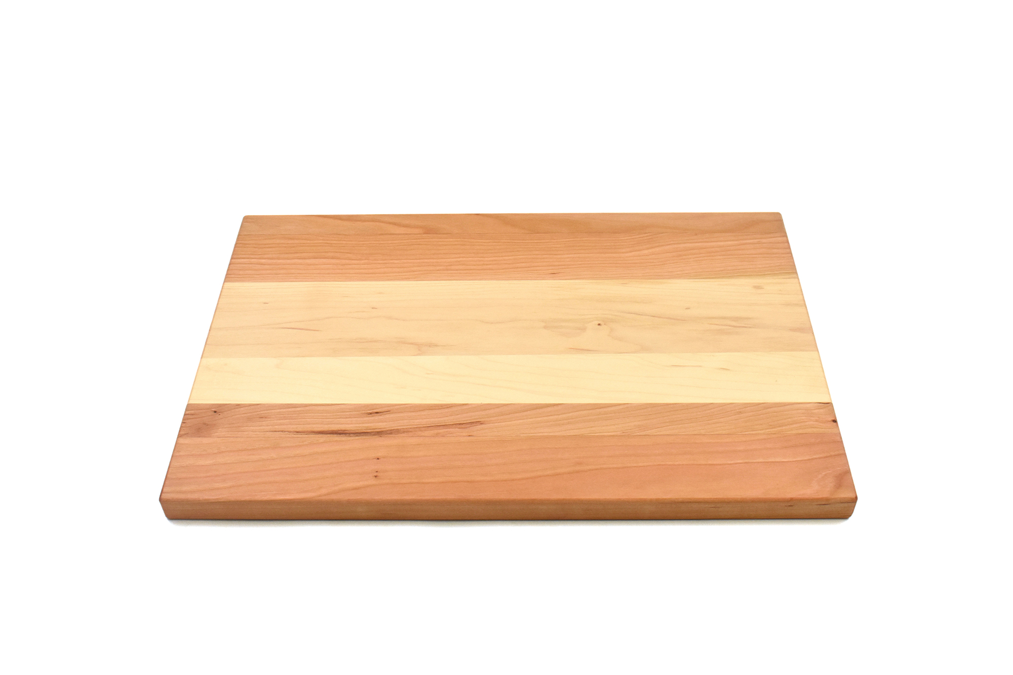Large multi wood species cutting board with maple in the middle