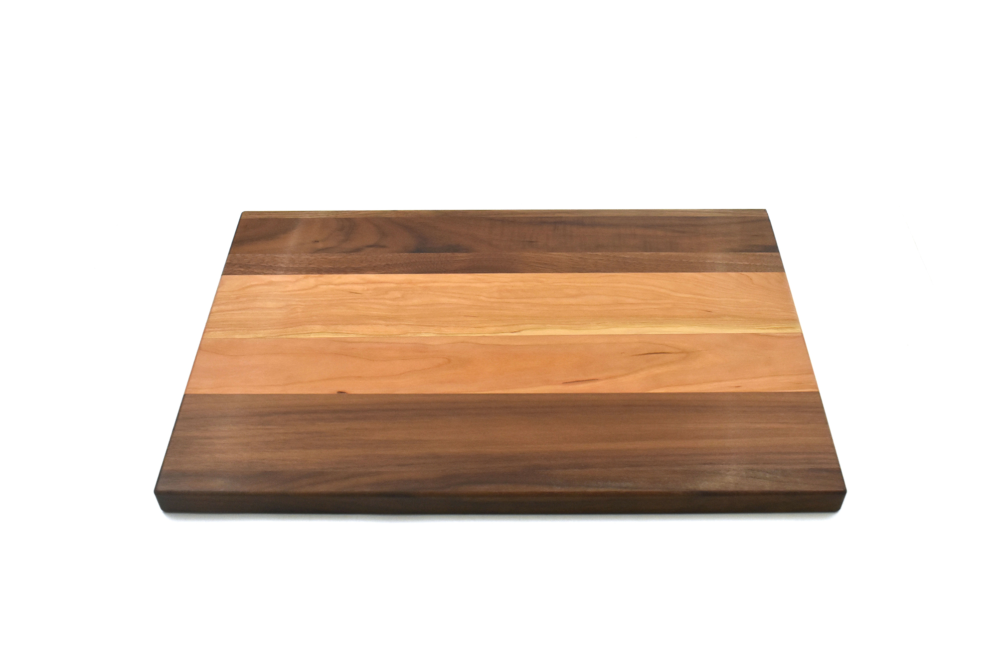 Large multi wood species cutting board with cherry in the middle