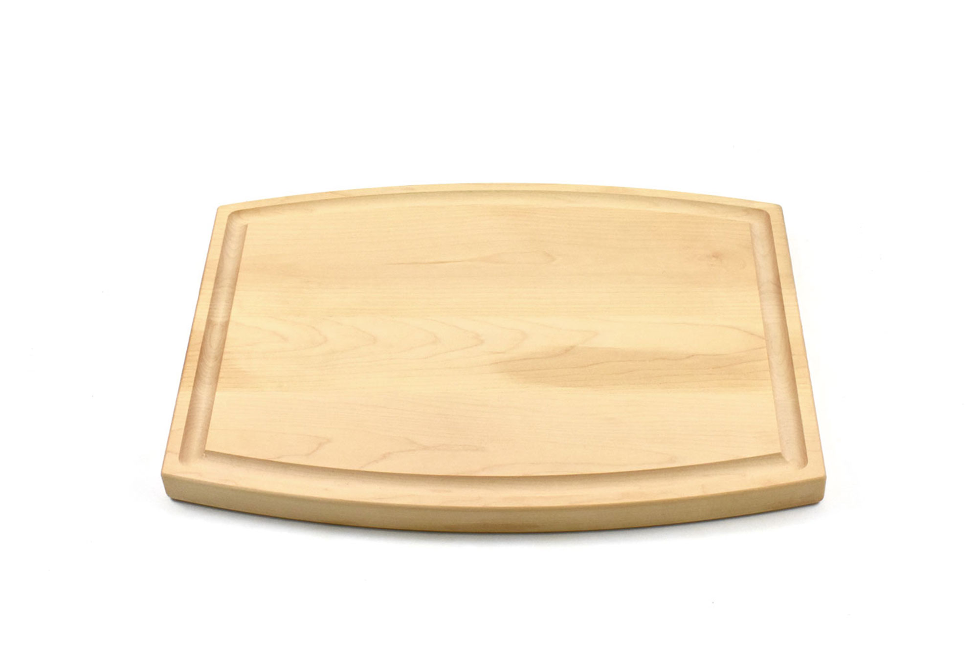 Arched wood cutting board with juice groove