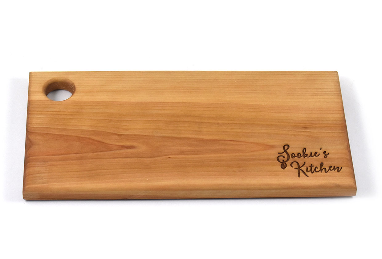 Artisan wood cutting board with engraving